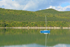 Sailboat. A lone sailboat on a huge lake Stock Image