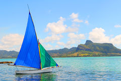 Sailboat in Mahebourg bay. Royalty Free Stock Images