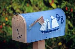 Sailboat Mailbox. A cheerful mailbox hand painted with a sailboat royalty free stock photos