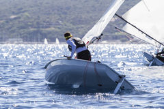 Sailboat. Maneuvering sailor during a racing Royalty Free Stock Image