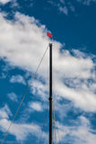 Sailboat Mast Blue Sky And Clouds Stock Photo