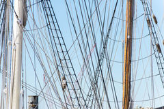 Sailboat masts, riggin and rolled up sails Royalty Free Stock Photos