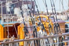 Sailboat masts, rigging and rolled up sails Stock Images