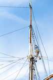 Sailboat masts, rigging and rolled up sails Royalty Free Stock Photos