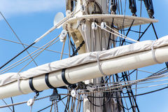 Sailboat masts, rigging and rolled up sails Royalty Free Stock Images