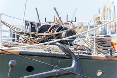 Sailboat masts, rigging and rolled up sails Stock Photos
