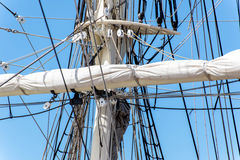 Sailboat masts, rigging and rolled up sails Royalty Free Stock Photography