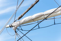 Sailboat masts, rigging and rolled up sails Stock Image