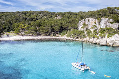 Sailboat in a mediterranean beach Stock Photo