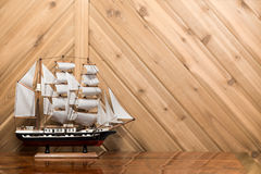 Sailboat / Model Ship against Plank Wall with Copy Space Royalty Free Stock Photos