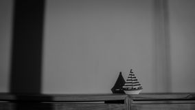 Sailboat model on table. Royalty Free Stock Photo
