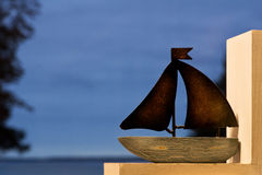 Sailboat. Model on the window, background blue sea and sky in the evening Stock Image