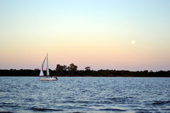 Sailboat and moon Stock Image