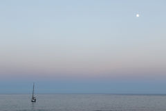 The sailboat and moon Stock Image