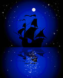 Sailboat in the moonlight. Silhouette of a sailing ship at night under the moon Royalty Free Stock Photos
