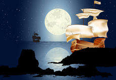 A Sailboat In The Moonlight. Two sailboats in the moonlight. Seascape with full moon Royalty Free Stock Image
