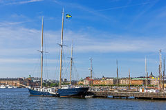 Sailboat moored in front of the Vasa Museum. On the Djurgarden island. In the background Strandvagen, boulevard considered the most prestigious avenue in town Royalty Free Stock Photos