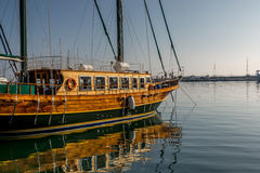 Sailboat moored at port. Beautiful wood sailboat moored at the port Royalty Free Stock Image