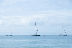 Sailboat moored in the sea. Sailboats moored close to the sea coast Royalty Free Stock Image
