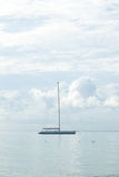 Sailboat moored in the sea. Sailboats moored close to the sea coast Royalty Free Stock Images