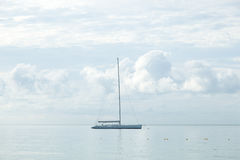 Sailboat moored in the sea. Sailboats moored close to the sea coast Royalty Free Stock Photo