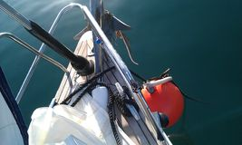 Sailboat at a mooring buoy Stock Images