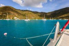 Sailboat mooring in BVI. Sailing catamaran on a mooring ball in a harbor in British Virgin Islands Stock Photography