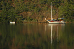 Sailboat with morning reflections Royalty Free Stock Photos