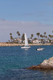 Sailboat and a motorboat leaving the harbor. In Corona del Mar, California in summer royalty free stock photo