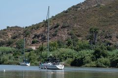 Sailboat and motorboat moored on Rio Guadiana stock photo