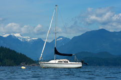 Sailboat and the mountains. Yacht on the water against the mountain backdrop stock photos
