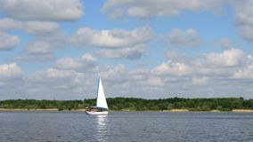 Sailboat in the mouth of the river stock footage