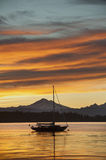 Sailboat and Mt. Baker. A sailboat anchors off of Lummi island, located in the San Juan Islands of the Puget Sound area of western Washington state. The volcano Stock Photography