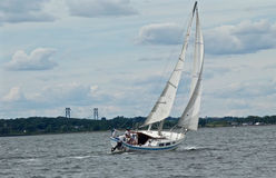 Sailboat in Narragansett Bay with Mt. Hope Bridge in Background Royalty Free Stock Photo