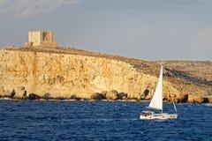 Sailboat navigates inshore in Gozo, Malta Stock Photography