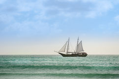 Sailboat navigating as a background in Aruba Stock Photos