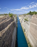 Sailboat navigating the narrow Canal of Corinth, in Greece. Royalty Free Stock Photos