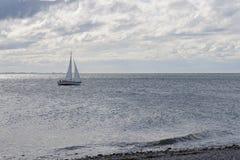 Sailboat near the Coast Royalty Free Stock Photo