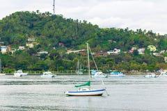 Sailboat near the coast Stock Photos