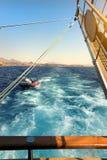 Sailboat near coastline Stock Images
