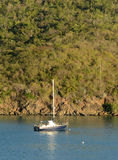 Sailboat near exotic coast Royalty Free Stock Images