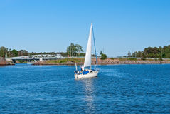 Sailboat near Hevossalmi bridge Royalty Free Stock Images
