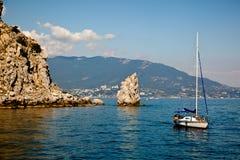 Sailboat near mountains Stock Photo