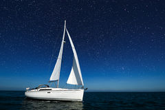 Sailboat at night with stars stock image