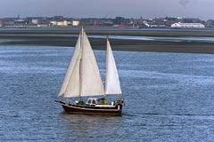 Sailboat Nortada in the entrance channel to Esbjerg, Denmark.. Royalty Free Stock Photo