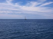 Sailboat on the ocean Royalty Free Stock Photo