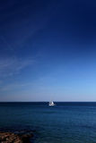 The Sailboat and the Ocean Royalty Free Stock Images