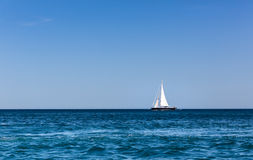 Sailboat in the ocean Stock Photo