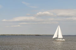 Sailboat in the ocean Royalty Free Stock Photos