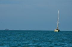 Sailboat in the ocean Stock Images